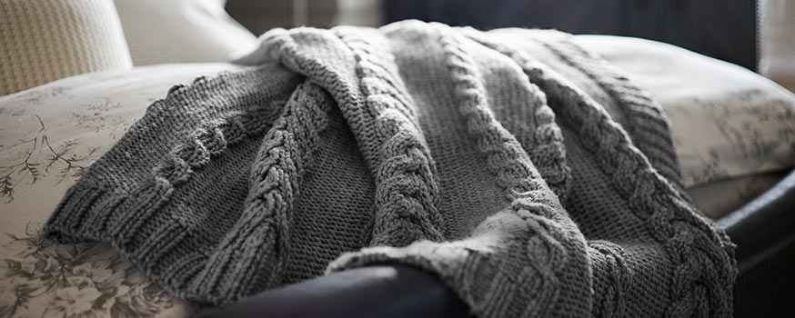 Grey hand-knit blanket