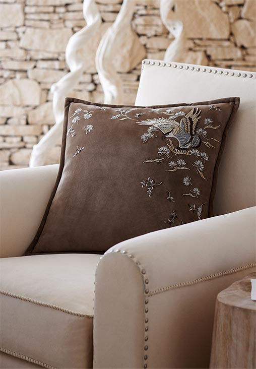 White pillows and bedding in woven, plush or embroidered textures