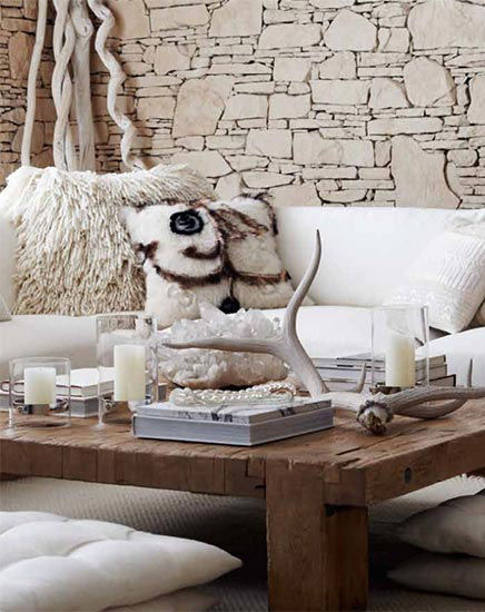 Room decorated with plush textiles & natural accents in cream tones