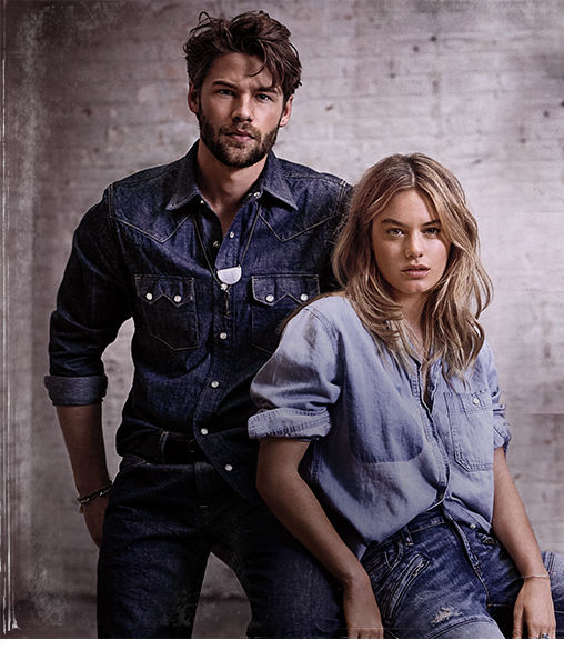 Man & woman wear chambray shirts & distressed denim